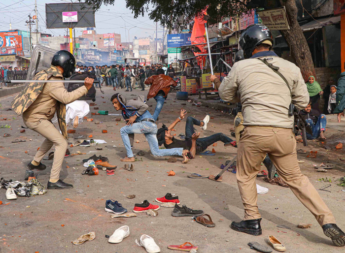 Police personnel baton charge at protesters during their rally against the NRC and the amended Citizenship Act that turned violent, in Lucknow, on December 19, 2019.