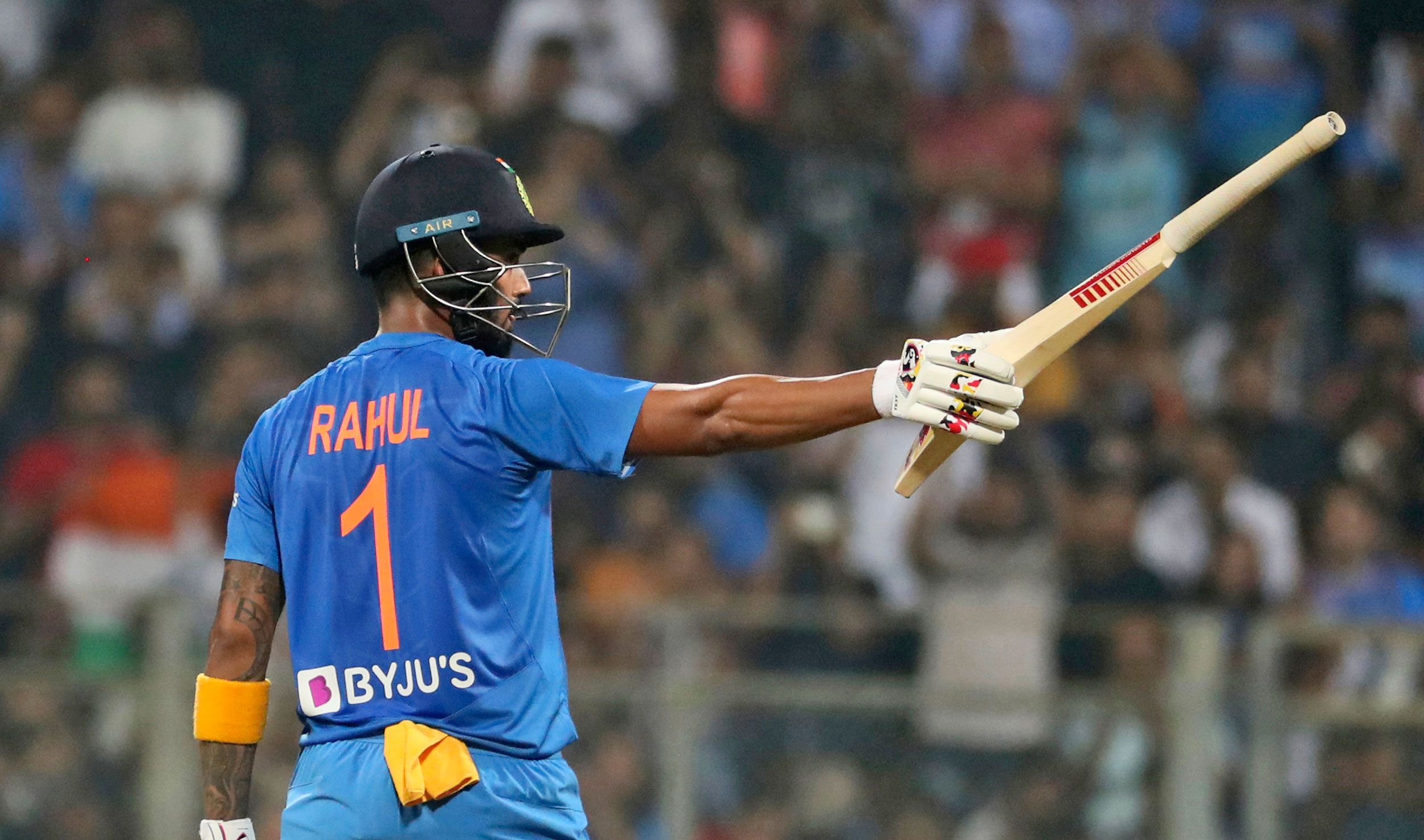 Lokesh Rahul raises his bat after scoring 50 runs during the third Twenty20 international cricket match between India and West Indies in Mumbai on Wednesday.