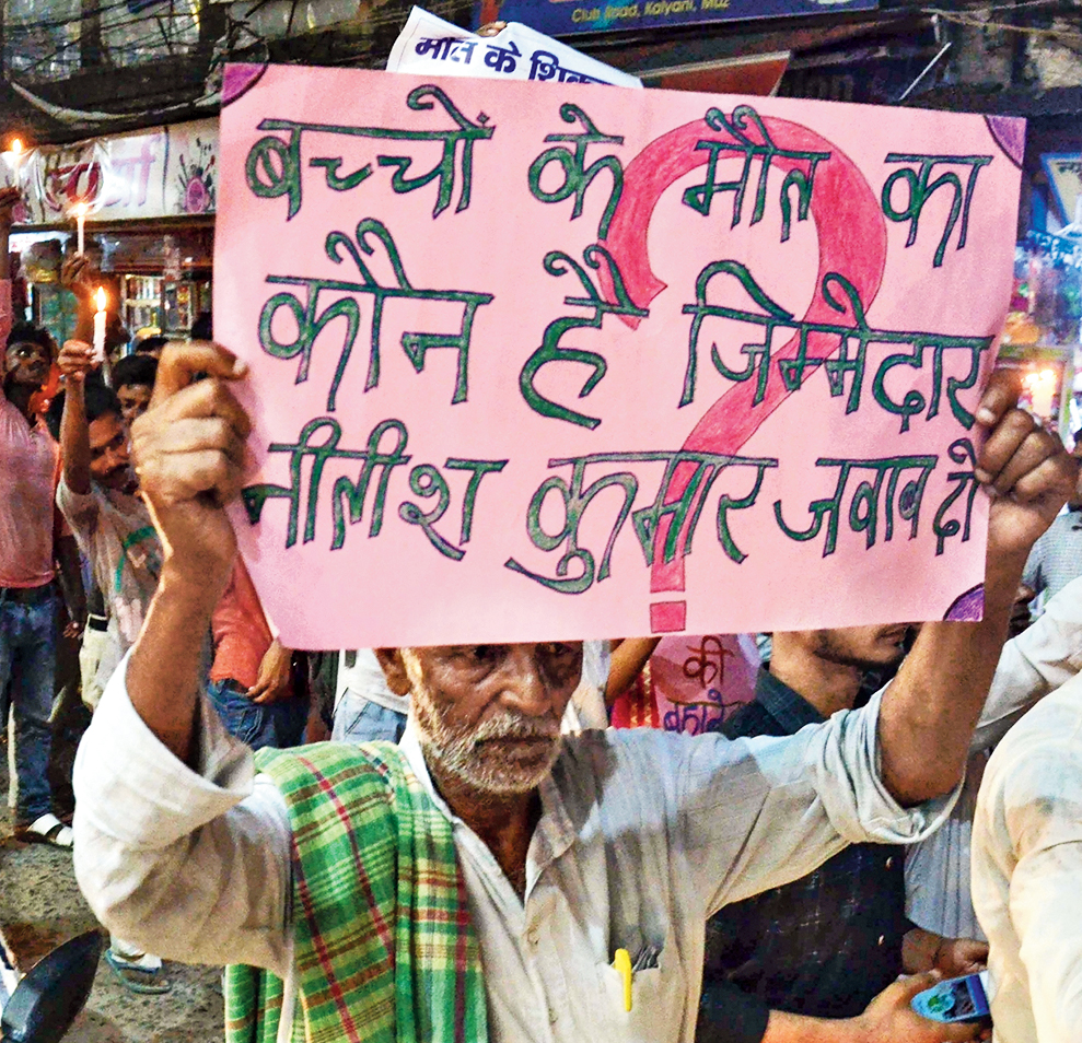 A man takes part in a march on Sunday to protest against the death of children in Muzaffarpur.