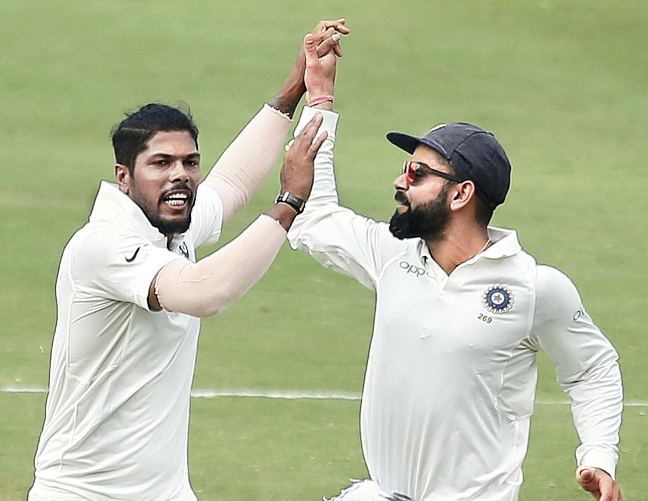 Umesh Yadav celebrates with Virat Kohli after dismissing Roston Chase in Hyderabad on Sunday.
