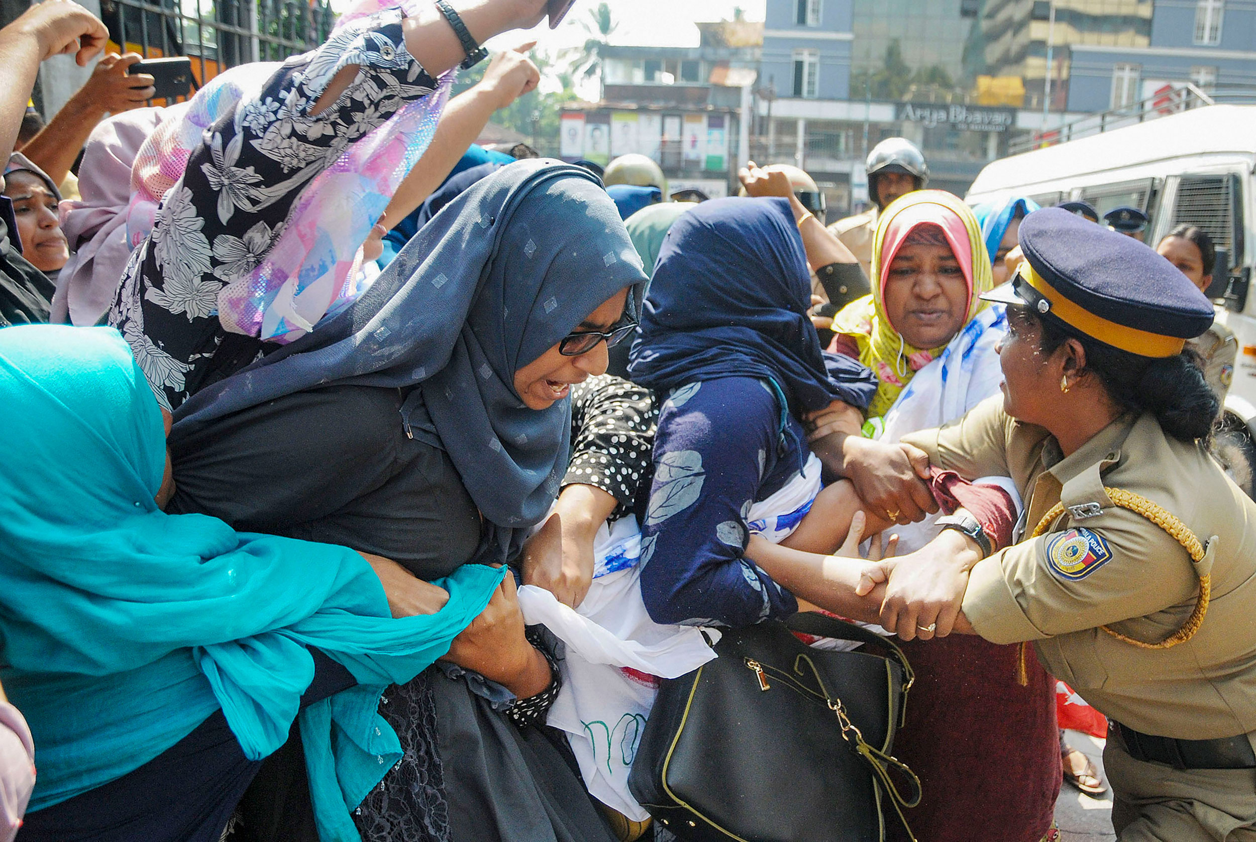 Police detain protesters in Kozhikode, Kerala. on Tuesday.