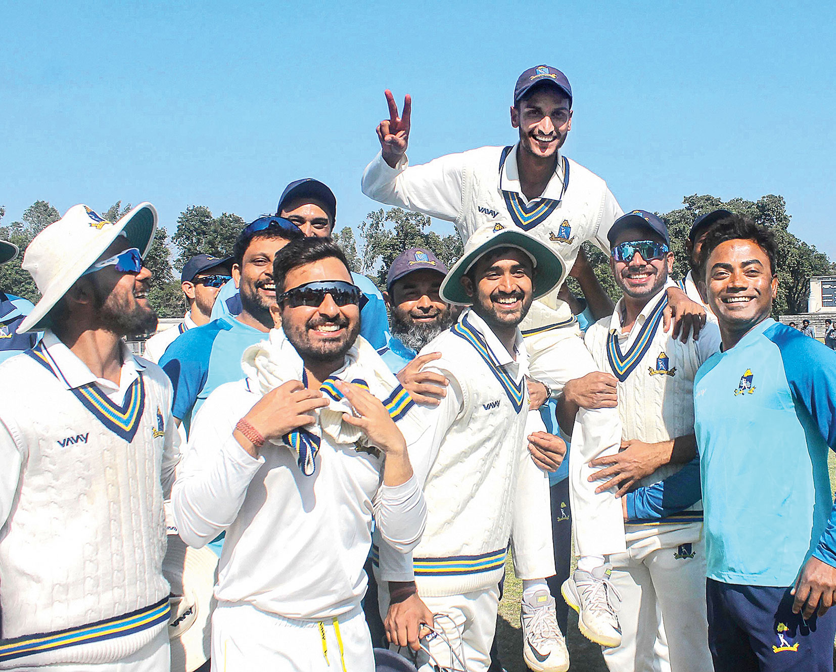Teammates carry Shahbaz Ahmed after Friday's win