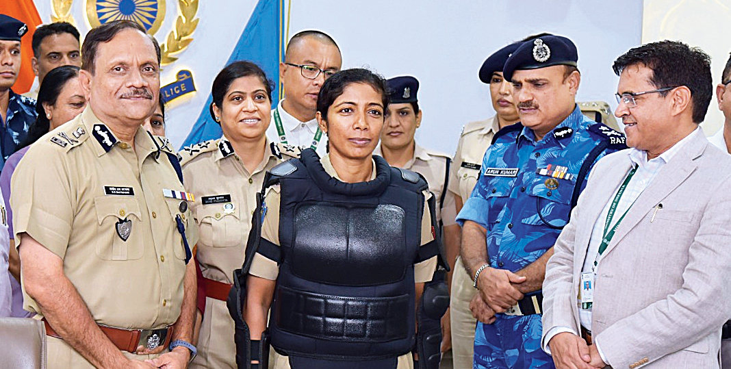 A woman officer dressed in the gender-specific body protector.