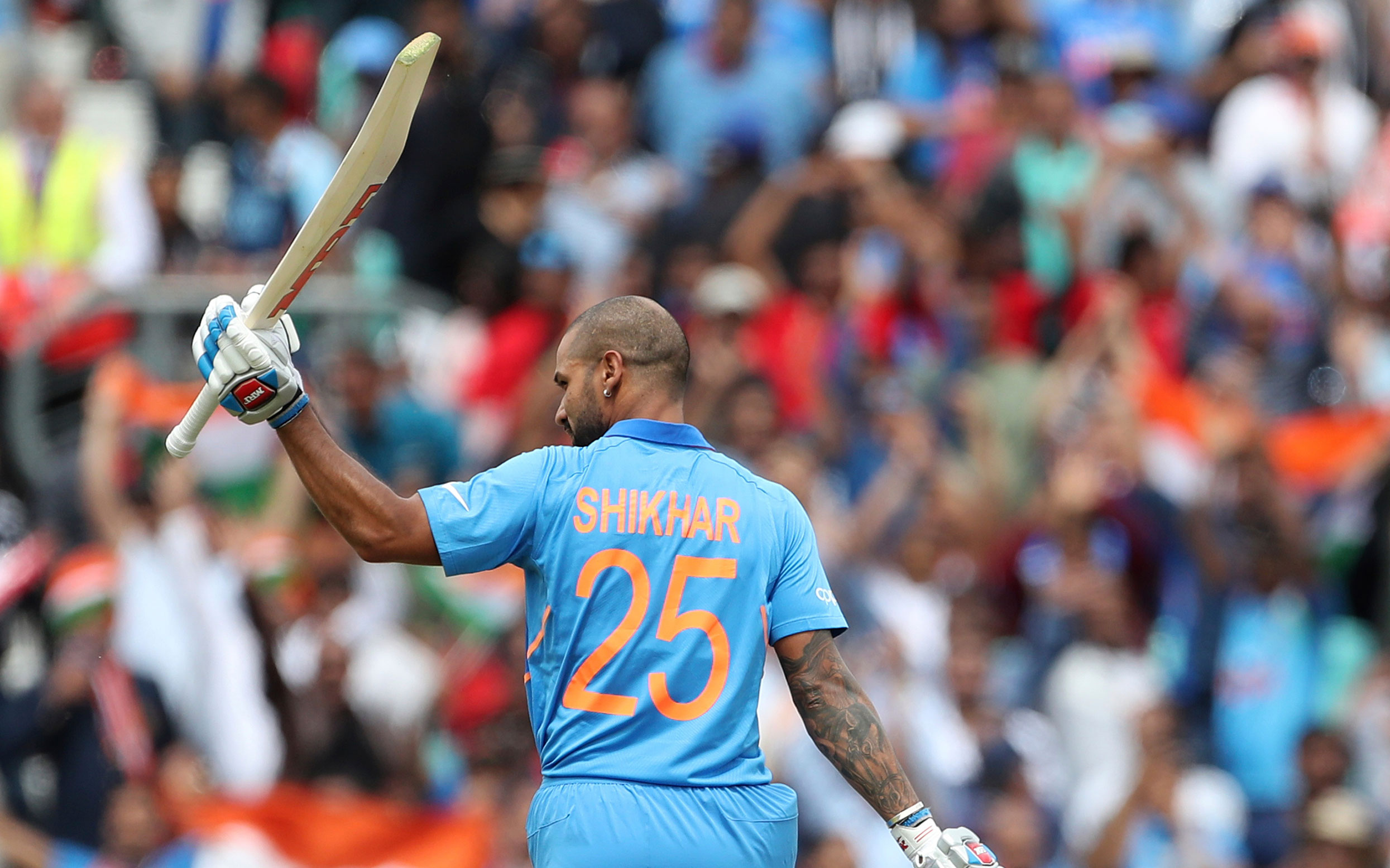 Shikhar Dhawan celebrates his century against Australia at The Oval in London, on June 9, 2019.