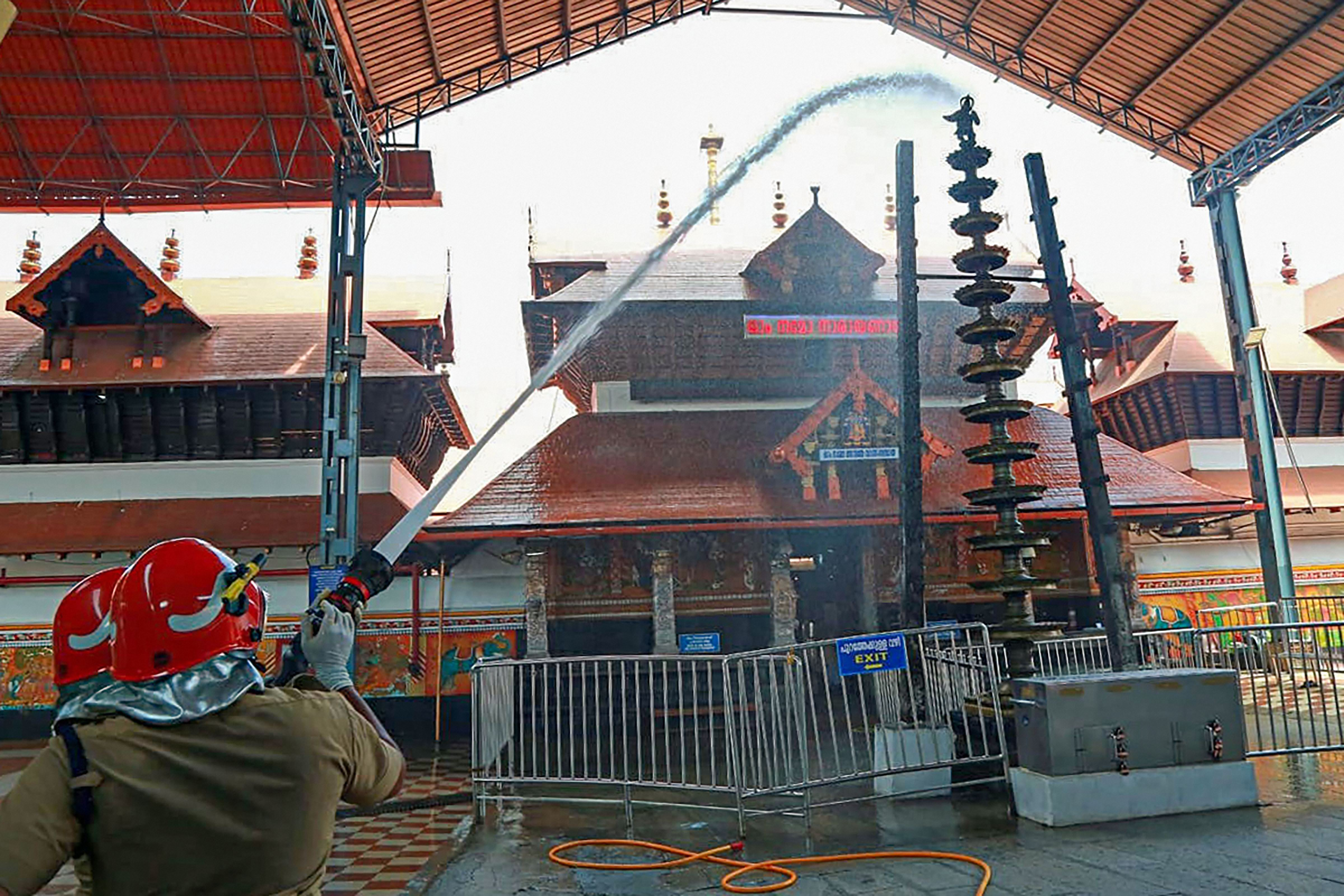 Guruvayur Sri Krishna temple being cleaned ahead of its reopening in Kochi on Monday.