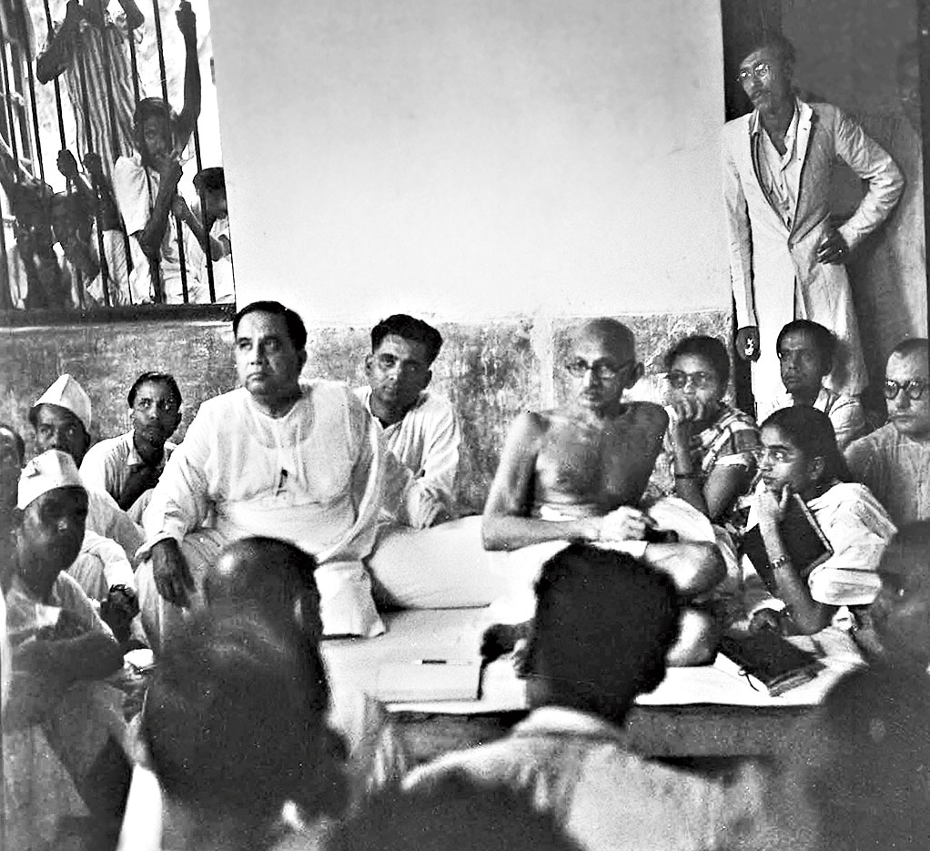 H.S. Suhrawardy with Gandhi in the same house in 1946