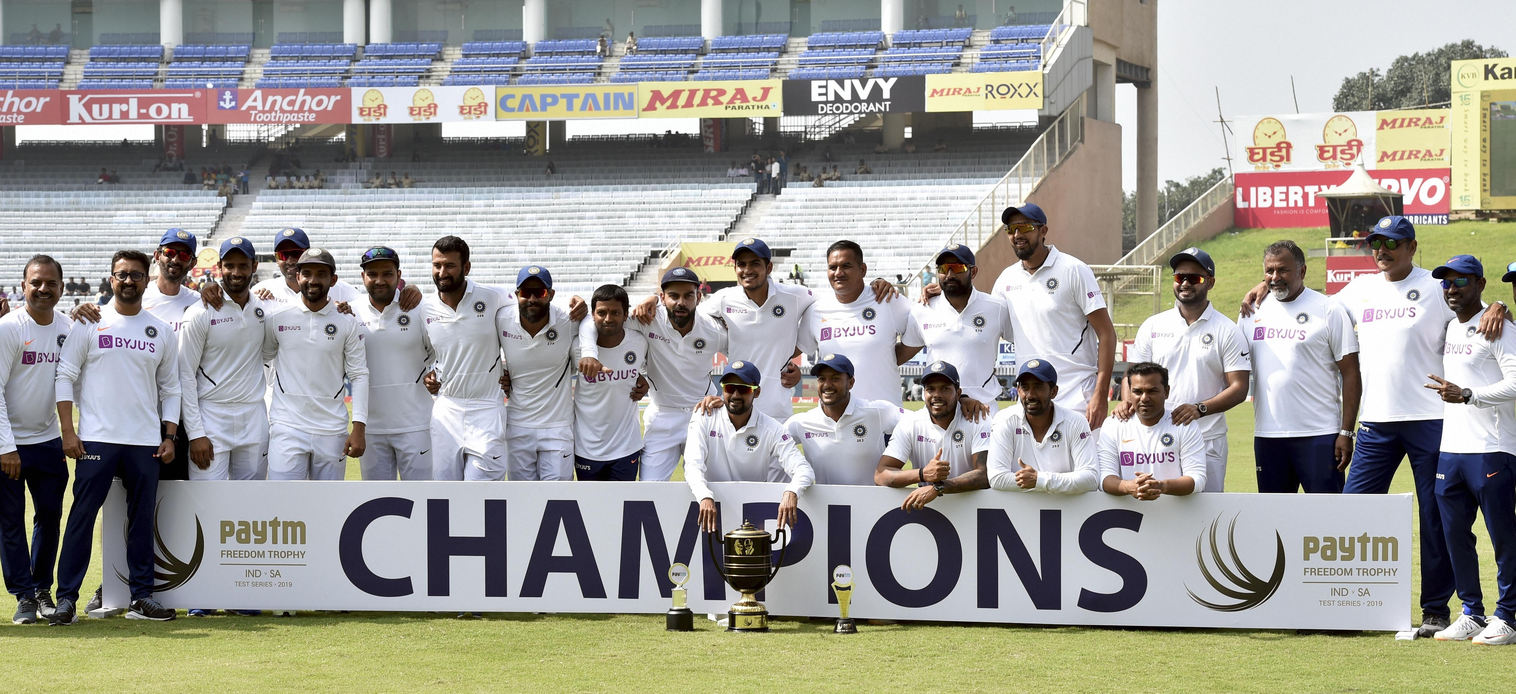 India captain Virat Kohli and team players pose with the trophy after winning the India vs South Africa Test series at JSCA Stadium, in Ranchi, Tuesday, October 22, 2019.