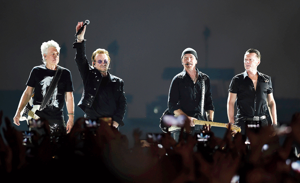 U2 bassist Adam Clayton, frontman Bono, lead guitarist Edge and drummer Larry Mullen Jr on stage at the D.Y. Patil Sports Stadium in Navi Mumbai