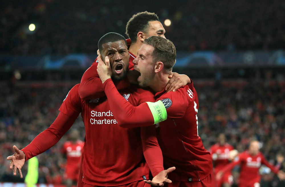 Georginio Wijnaldum, left, celebrates scoring his side's third goal of the game during the Champions League semi-final between Liverpool and Barcelona at Anfield, Liverpool,  on Tuesday