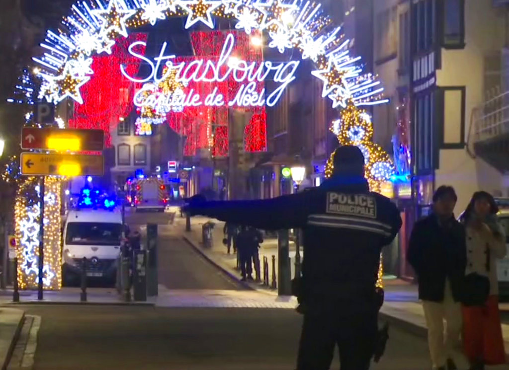 In this image made from video, emergency services arrive at the Christmas market in Strasbourg on Tuesday.