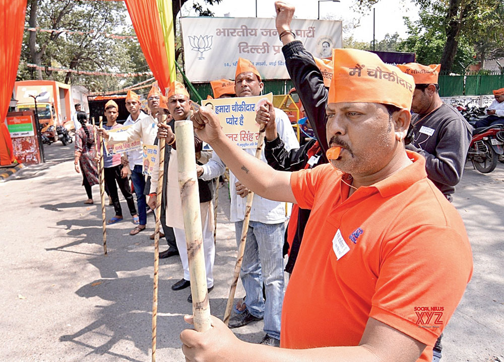 "BJP workers participate in the ""Main Bhi Chowkidar"" campaign at the party's headquarters in New Delhi, on March 20, 2019."