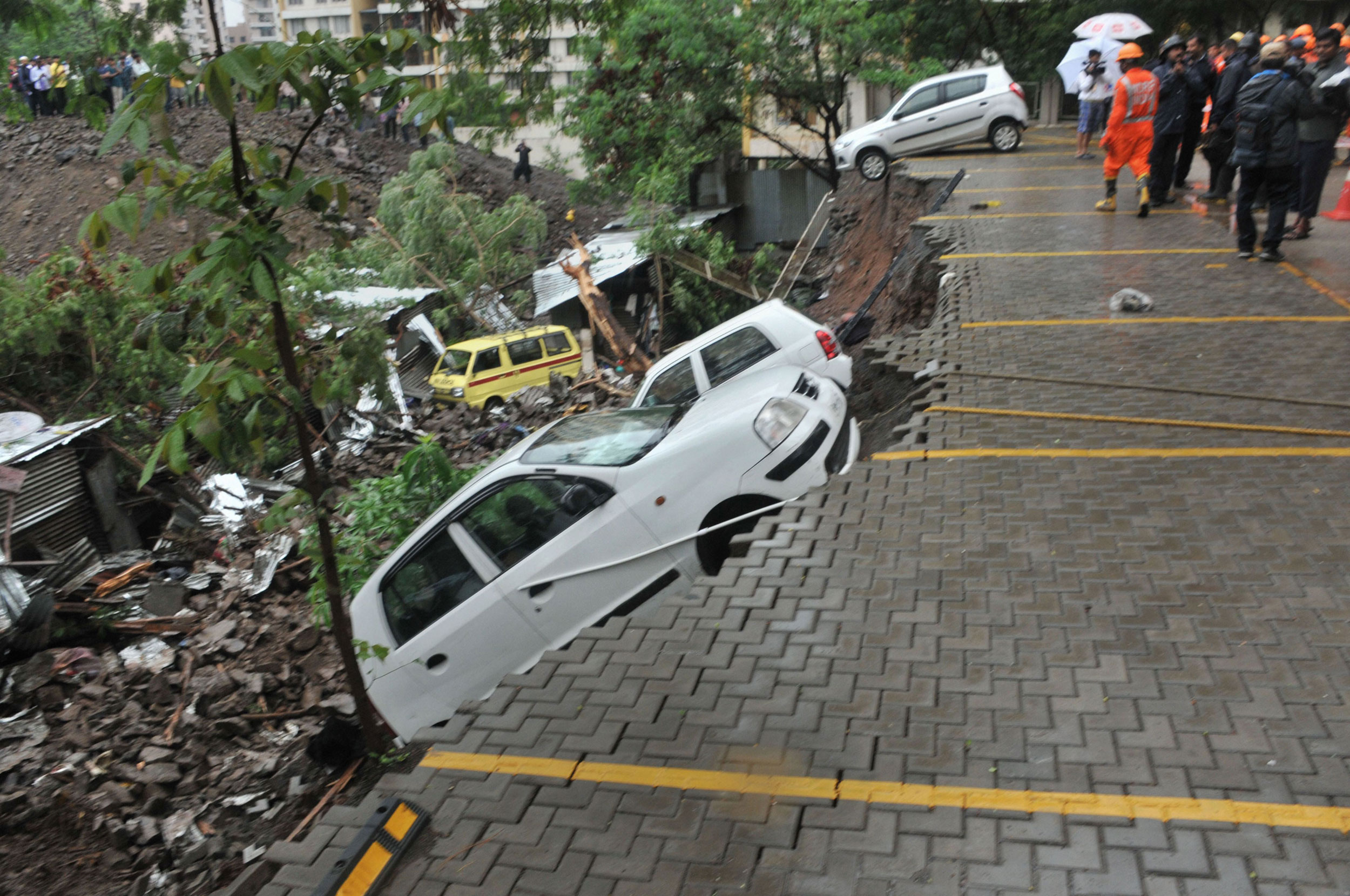 A damaged car at the collapse site in Pune on Saturday.