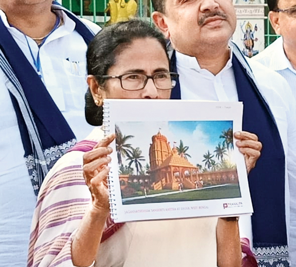Mamata on Tuesday shows an artist's impression of the temple planned at Old Digha.