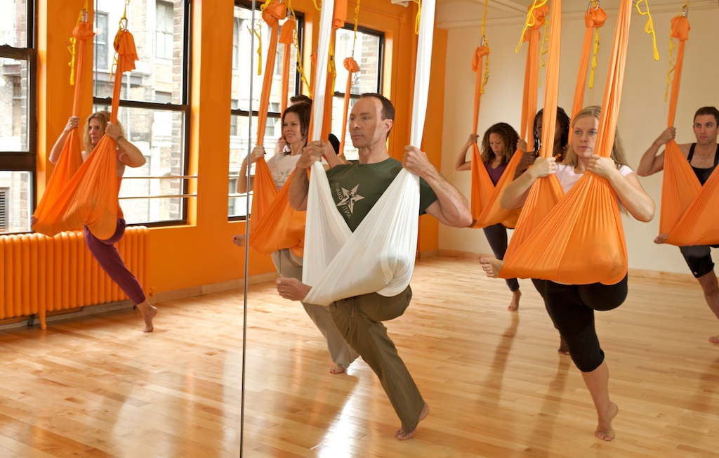 Aerial Yoga involves hanging from a hammock suspended from the ceiling