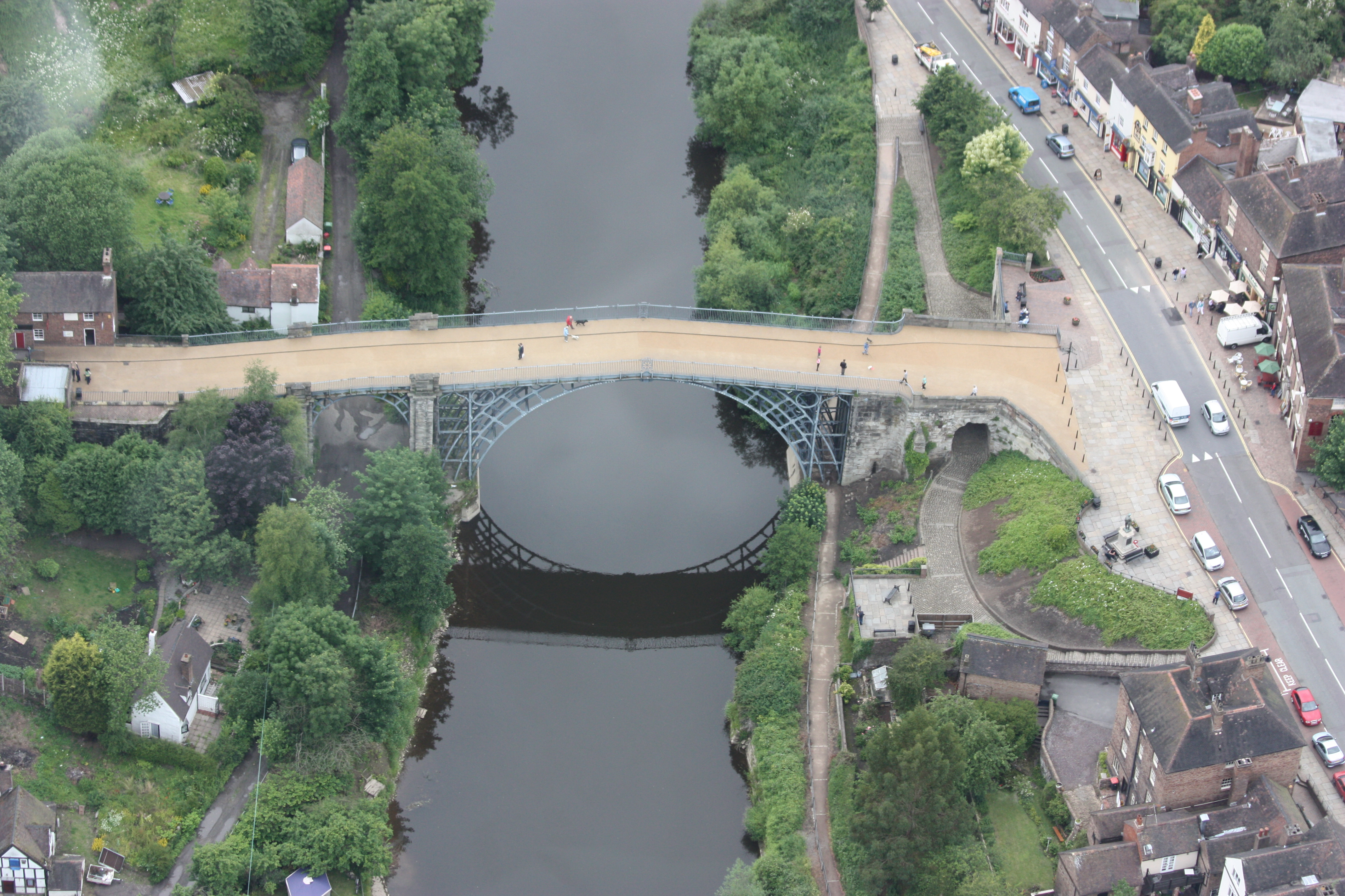 The first iron bridge, built at Coalbrookdale, England, in 1781. Its engineers used the same design they would have used for a masonry bridge. Within a hundred years, however, structures were being designed using scientific methods and quantitative design processes that made it possible to predict the performance of the new materials