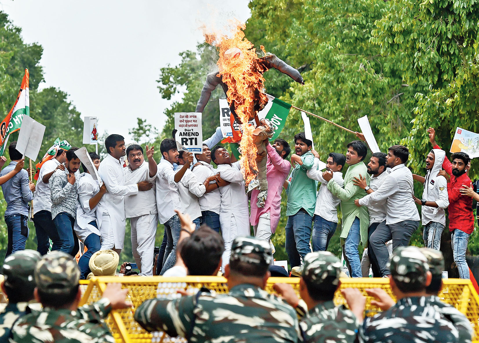 Members of Delhi Pradesh Youth Congress stage a protest against RTI Amendment Bill in New Delhi on Friday.