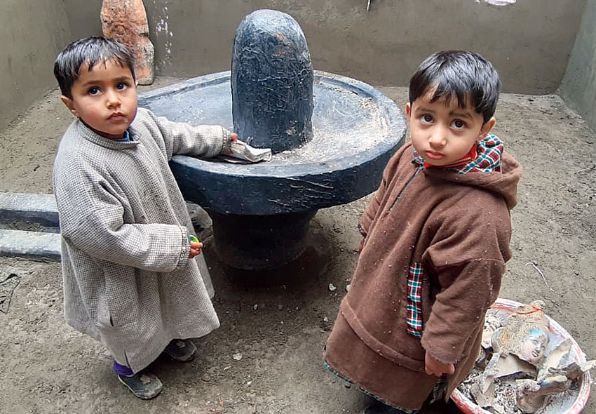 Children in the temple in Pulwama.