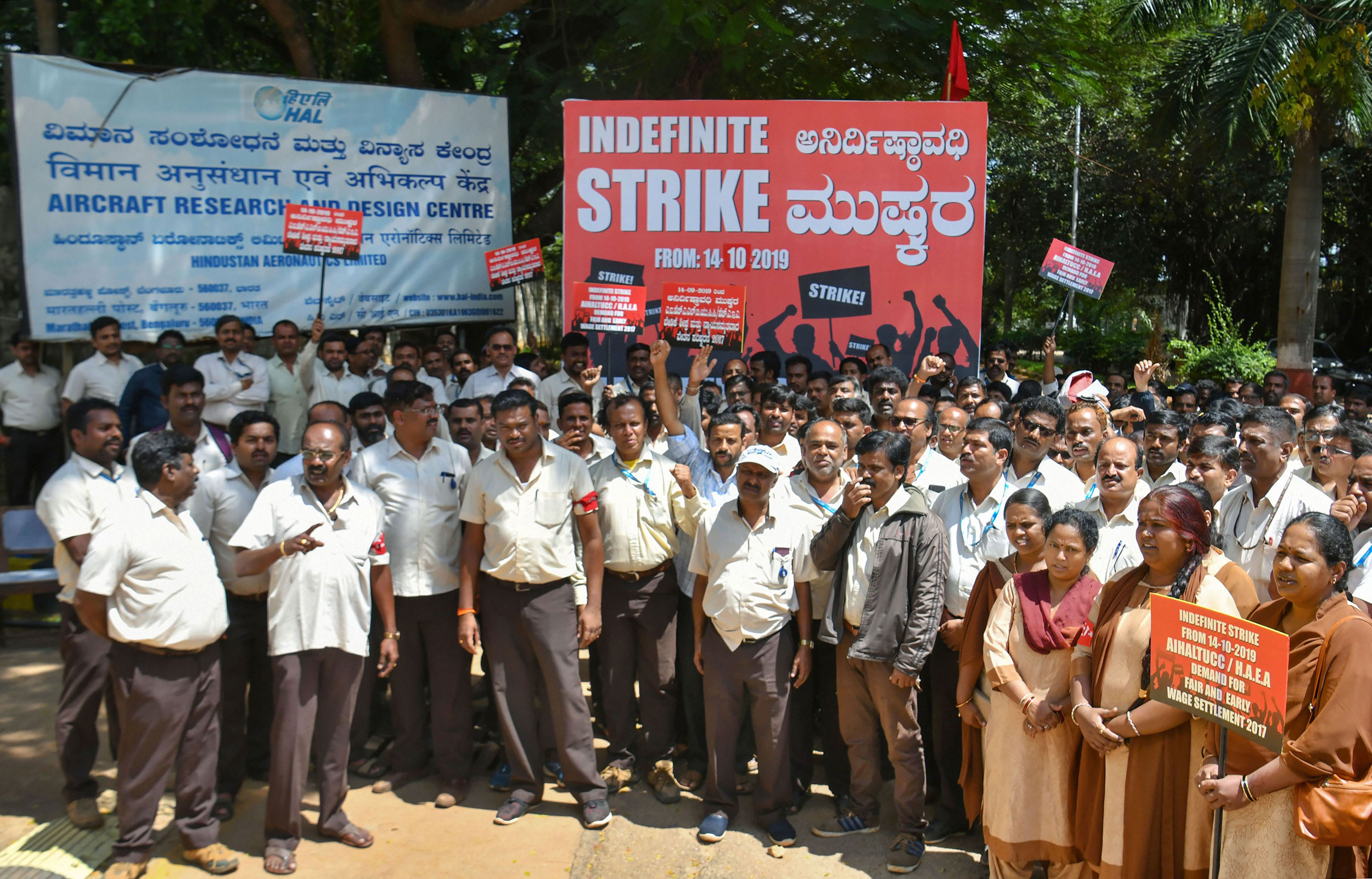 Members of All India HAL trade unions stage a protest during their strike in Bangalore on October 14, 2019.