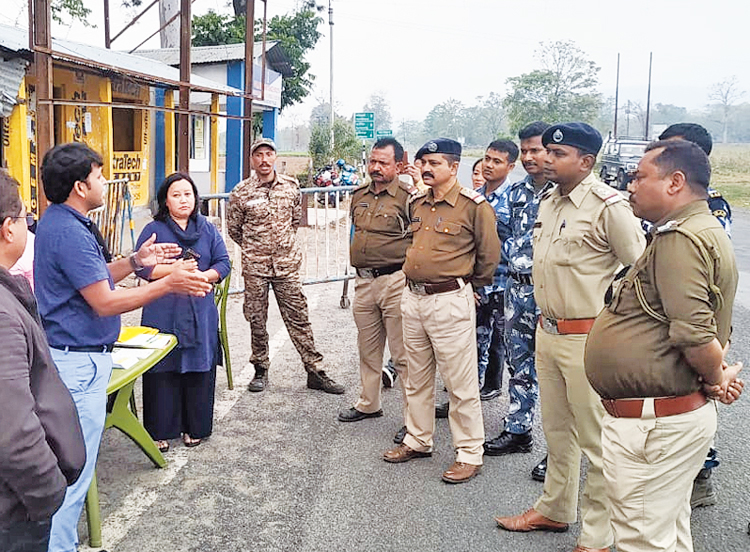 Police and health officials at a screening camp near Siliguri.