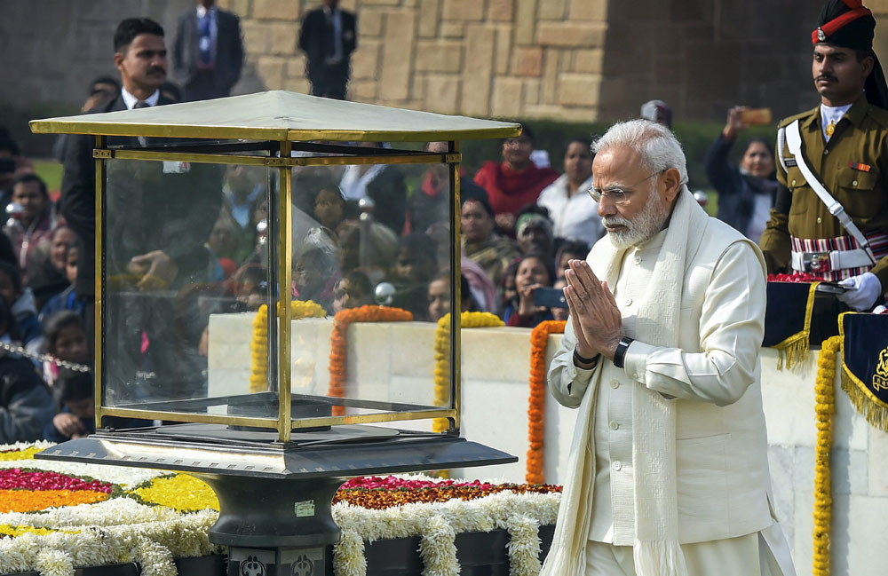PM Narendra Modi pays homage to Mahatma Gandhi on his 71st death anniversary at Rajghat in Delhi, Wednesday, Jan. 30, 2019.