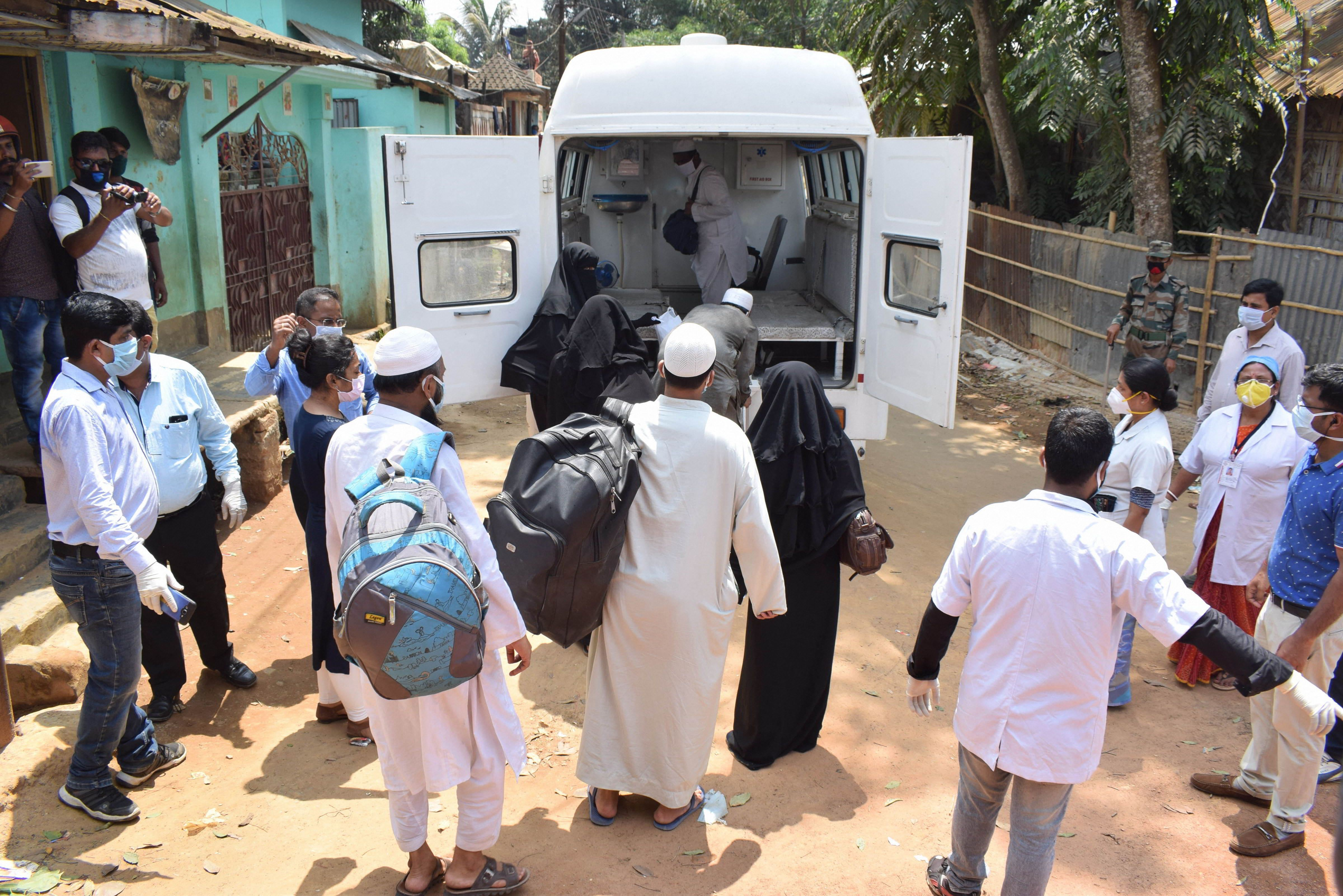 Attendees of a religious congregation in Delhi's Nizamuddin area board an ambulance for mandatory Covid-19 tests during a nationwide lockdown in the wake of the coronavirus outbreak, in Agartala, Saturday, April 4, 2020.