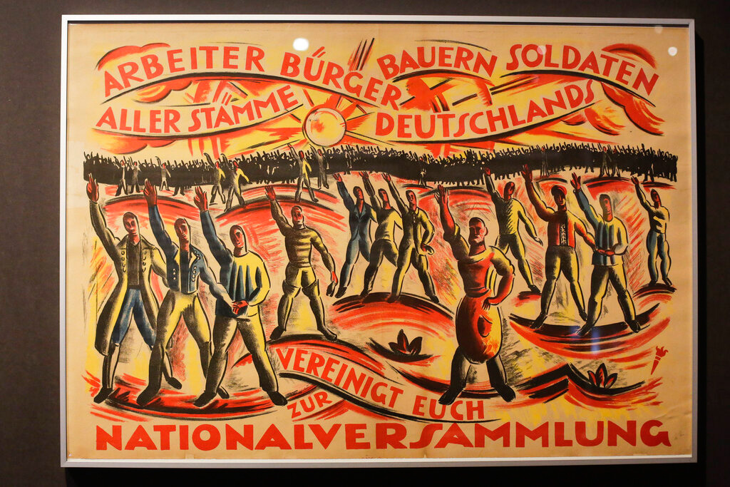 In this Wednesday, April 3, 2019 photo, a historic poster is displayed at the exhibition 'Weimar: The Essence And Value Of Democracy' at the German Historical Museum in Berlin, Germany.