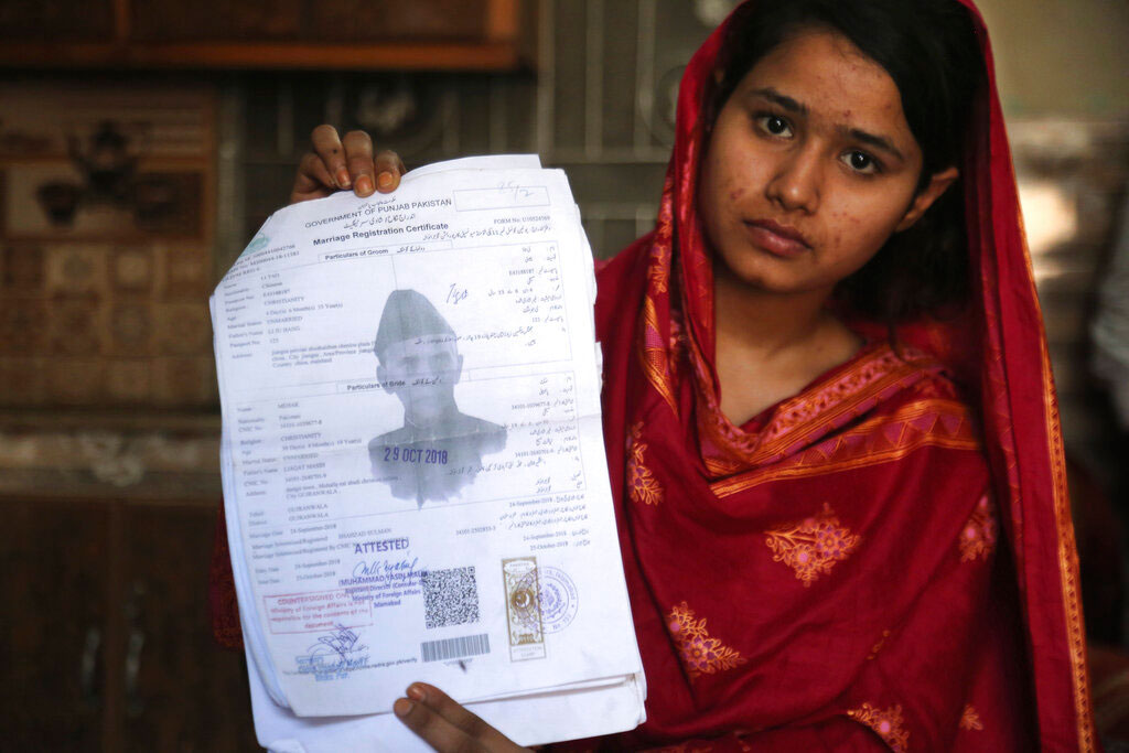 In this April 14, 2019 photo, Mahek Liaqat, who married a Chinese national, shows her marriage certificate in Gujranwala, Pakistan.