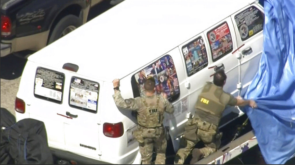 This frame grab from video provided by WPLG-TV shows FBI agents covering a van as it was transported from Plantation, Florida, on Friday.