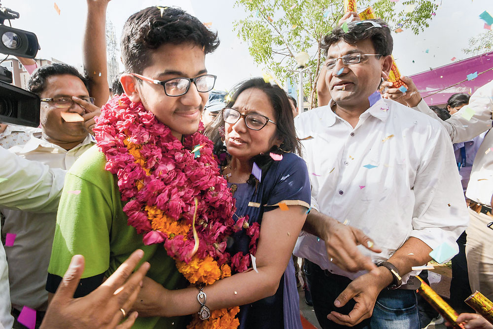 NEET topper Nalin Khandelwal celebrates with his parents after the results
