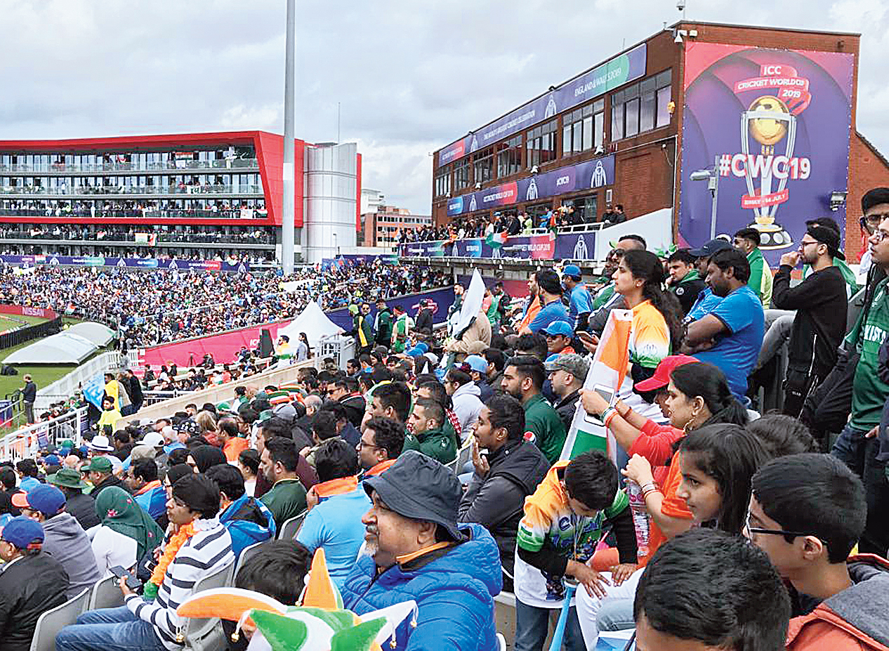 Indian and Pakistani supporters fill the stands at Old Trafford on Sunday.