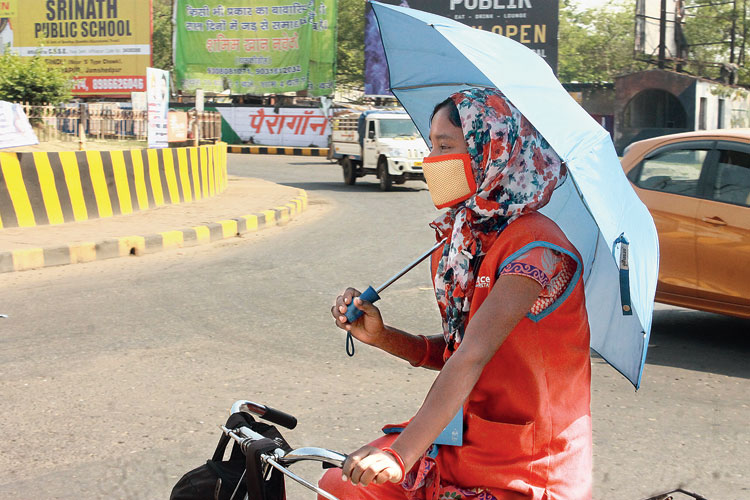 A woman rides a bicycle in Bistupur, Jamshedpur, on a hot Thursday.