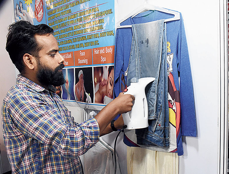 The steam iron (in picture) requires no pressure to be applied and smoothens clothes as they hang up on the wall