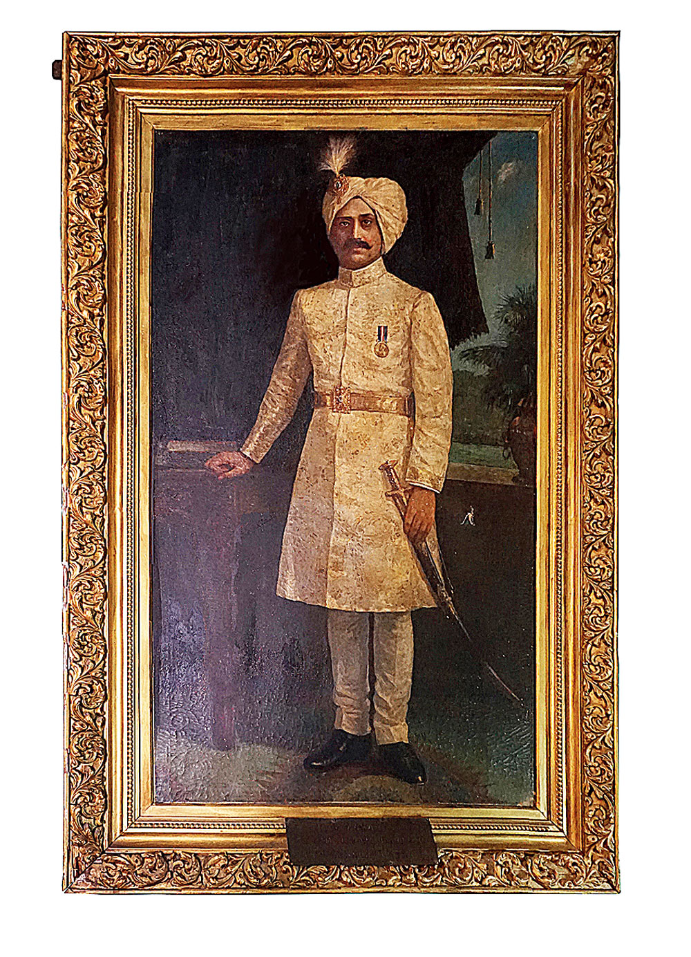 An oil painting of Sriram Chandra Bhanj Deo that adorns the palace walls along with spoils from the countless royal hunting expeditions