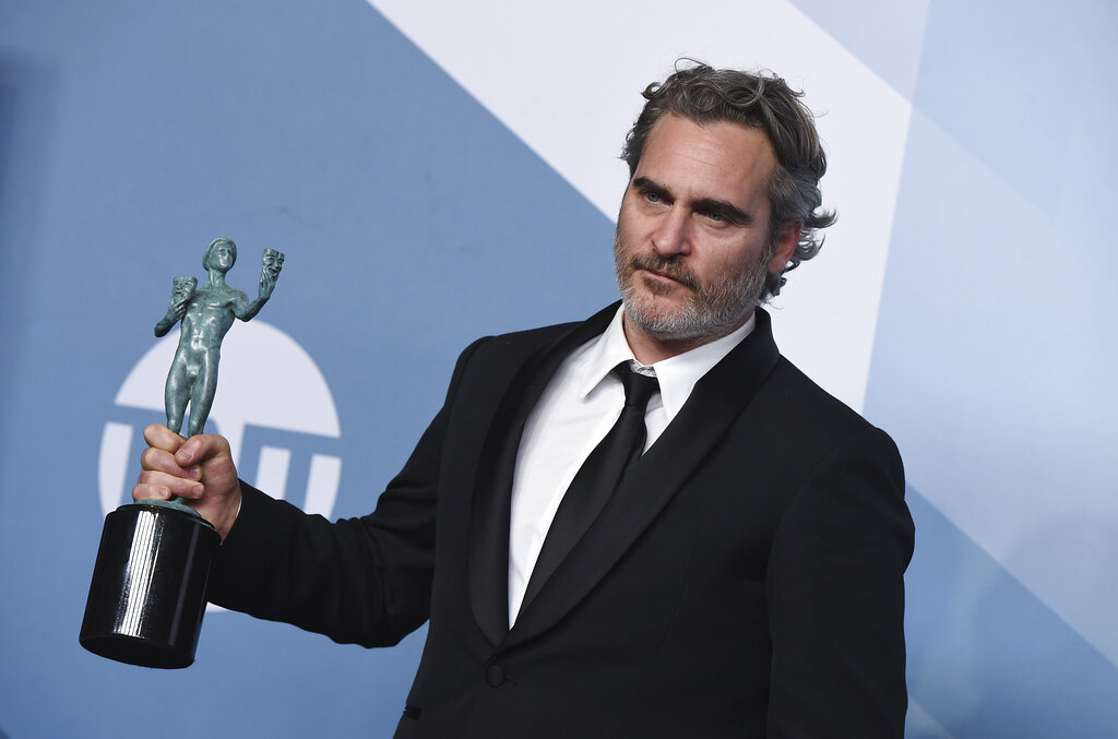 Joaquin Phoenix poses in the press room with the award for outstanding performance by a male actor in a leading role for