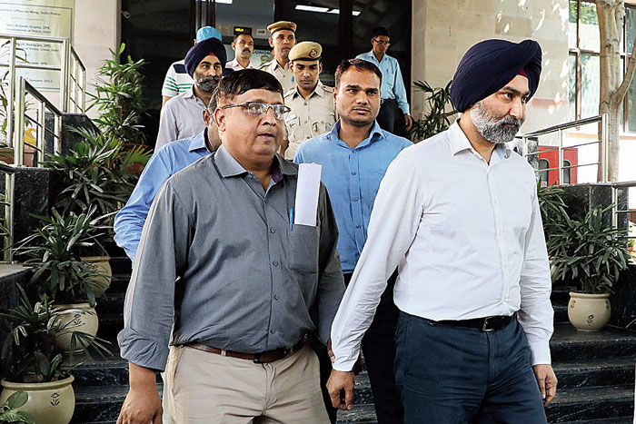 The Singh brothers inside the court premises in New Delhi on Friday, October 11, 2019