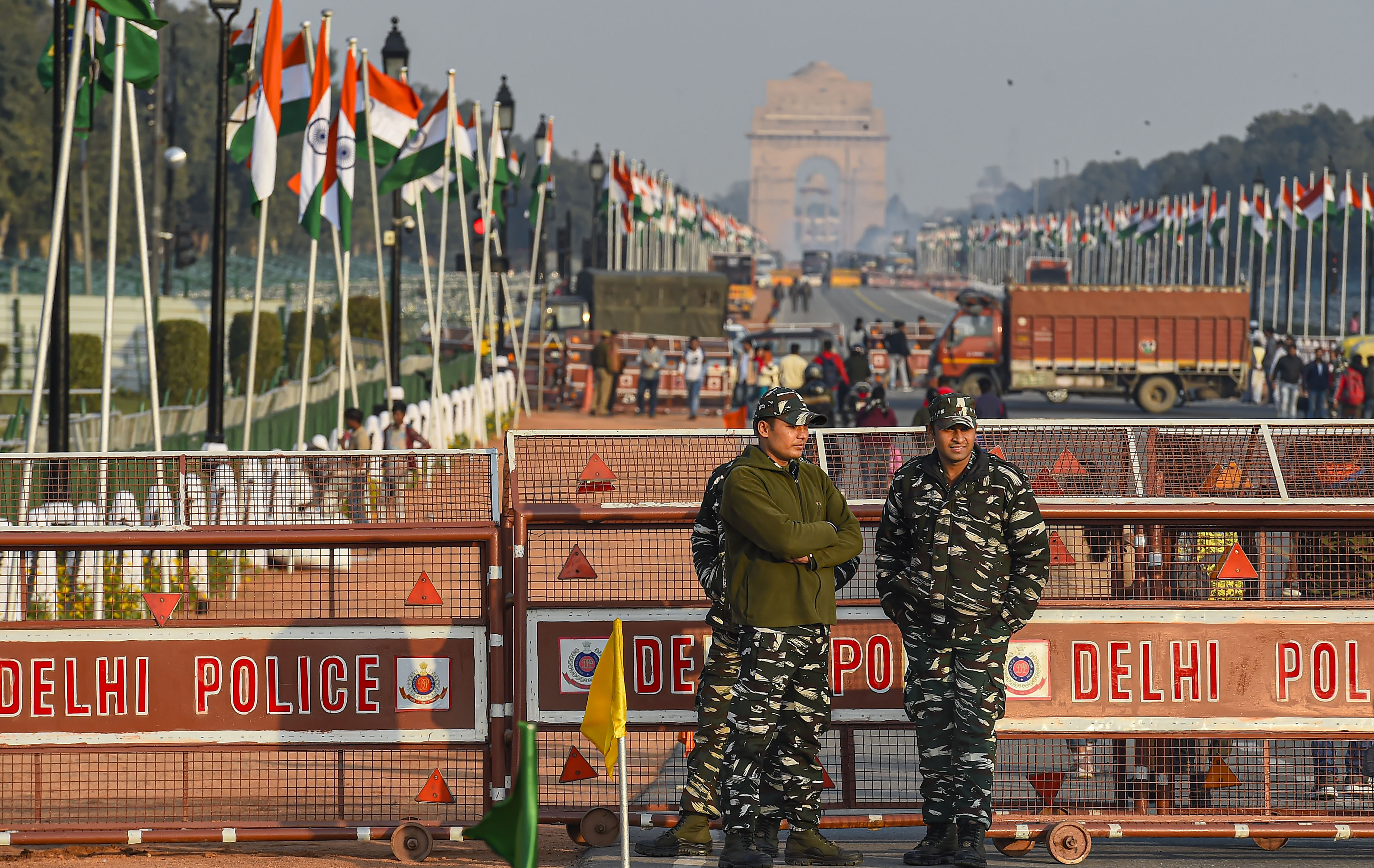 Security personnel stand guard at the Rajpath, which is decked up for the Republic Day Parade, in New Delhi, Saturday, January 25, 2020.