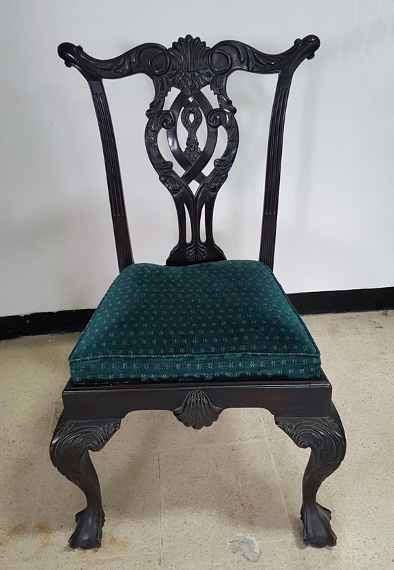 A black Chippendale chair