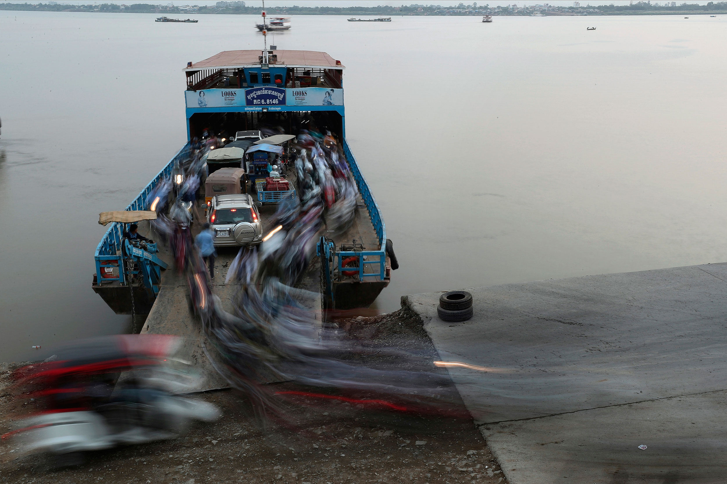 Passengers get off from a ferry after crossing the Mekong river from Arey Ksat to Phnom Penh, Cambodia, on Tuesday.