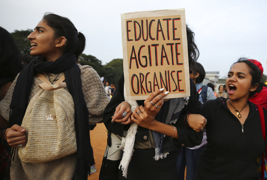 Students shout slogans and hold placards during a protest against the Citizenship Amendment Act in Bangalore, India, on December 20, 2019.