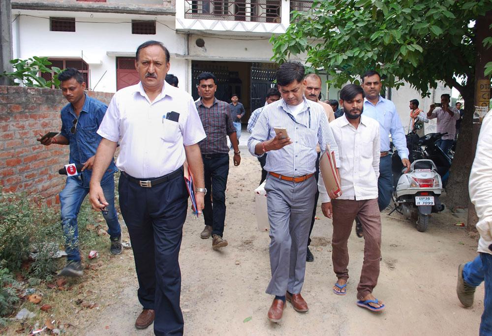 CBI officers at Gayatri Prajapati's residence in Amethi on Wednesday