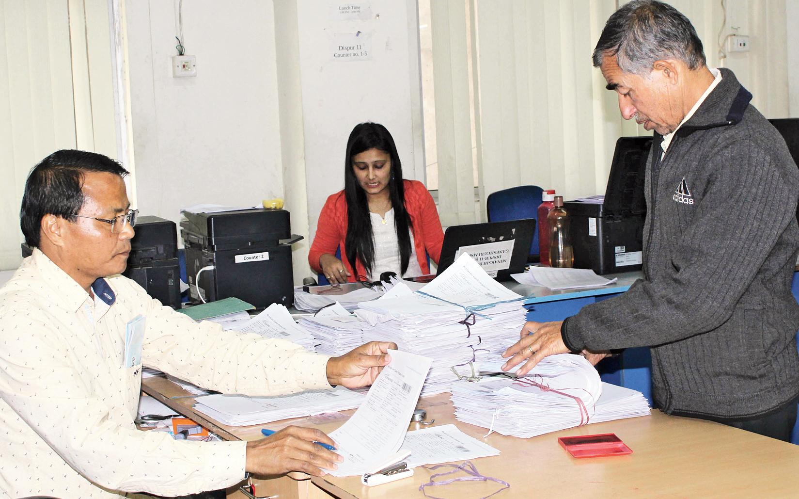 Officials at an NRC seva kendra