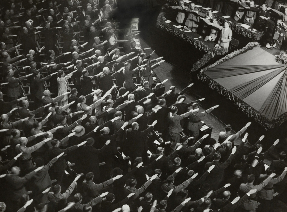 Attendees give Hitler the Nazi salute during the nation anthem on October 9, 1935.