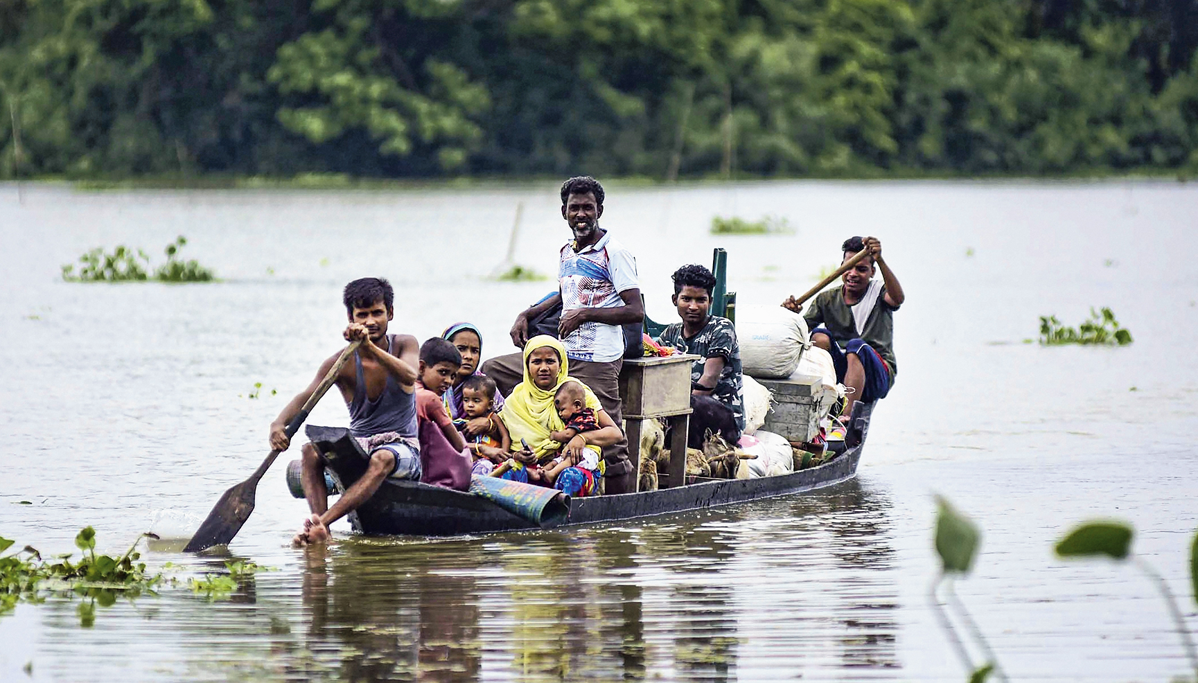 Villagers commute to safer places in Harmoti village near Kaziranga National Park in Nagaon of Assam.