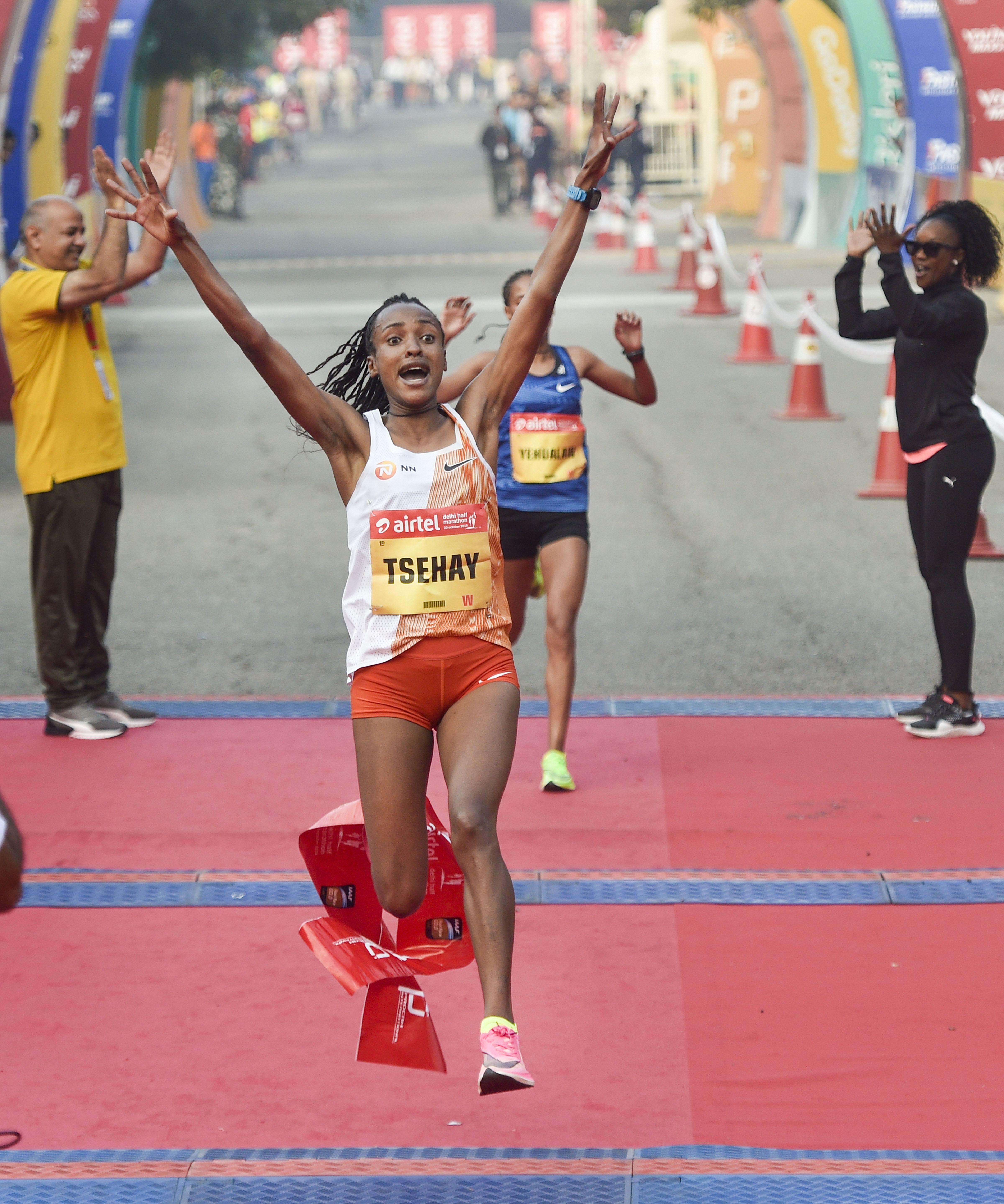 Defending champion Tsehay Gemechu crosses the finish line to retain her women's title at the 15th Airtel Delhi Half Marathon, at the Jawaharlal Nehru Stadium in New Delhi, Sunday, October 20, 2019