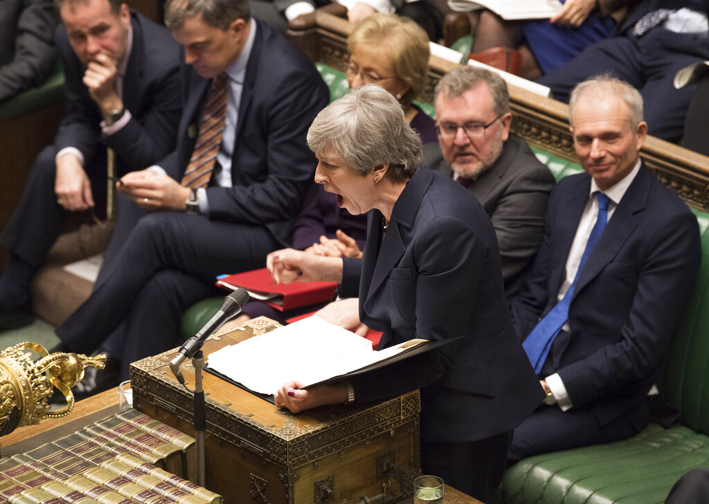 Theresa May stands to face opposition lawmakers inside the House of Commons Parliament in London on Wednesday.