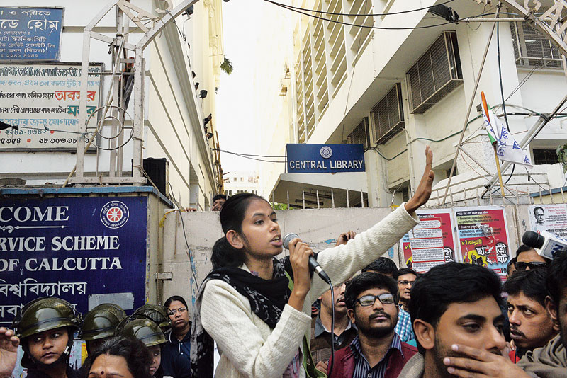 JNU Students' Union president Aishe Ghosh addresses a rally against the CAA, NRC and NPR in front of Calcutta University on Thursday.