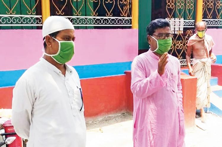 The Imam (left) with Forward Bloc leader Abdur Rauf at a village in Dinhata, Cooch Behar.