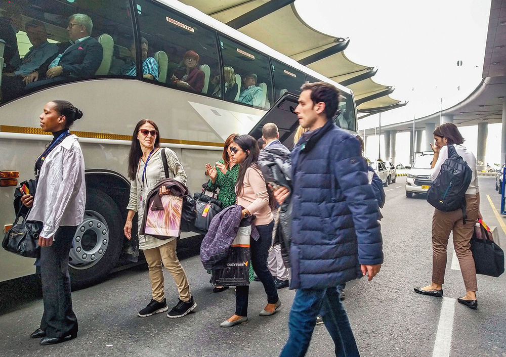 The members of the European Union Parliamentary delegation board a bus on arrival at Delhi airport on Wednesday after their visit to Jammu and Kashmir
