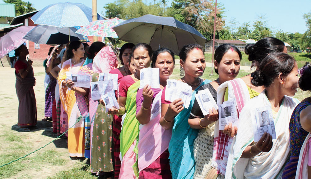 Women queue up to cast their votes in Sivasagar on Thursday