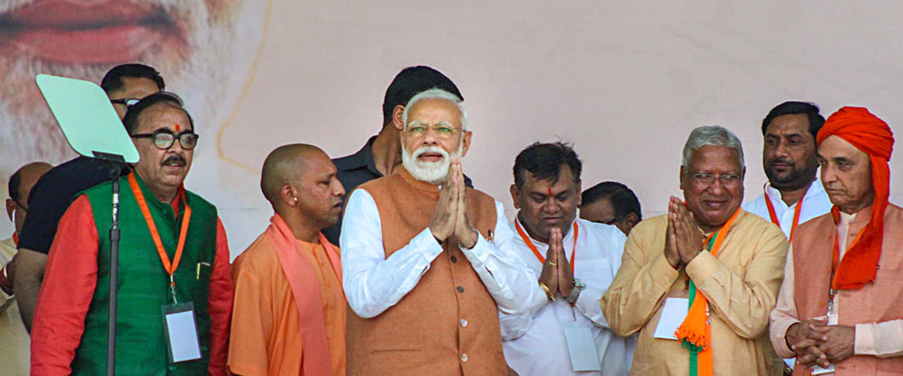 Prime Minister Narendra Modi with senior party leaders in Meerut on Thursday